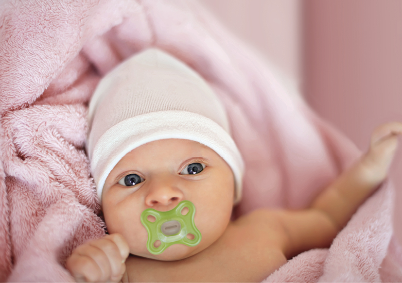 Baby mit Nuggi